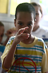 A boy points his finger at the camera in the Agent Orange children's ward of Tu Du Hospital in Ho Chi Minh City, Vietnam.  About 500 of the 60,000 children delivered each year at the maternity hospital, Vietnam's largest, are born with deformities, some because of Agent Orange, according to doctors. May 1, 2013.