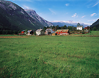 The village of Vetlefjord with a backdrop of mountains and snow-caps, in the Sognfjord region, Norwa