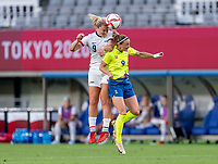 TOKYO, JAPAN - JULY 21: Lindsey Horan #9 of the USWNT goes up for a header with Kosovare Asllani #9 of Sweden during a game between Sweden and USWNT at Tokyo Stadium on July 21, 2021 in Tokyo, Japan.
