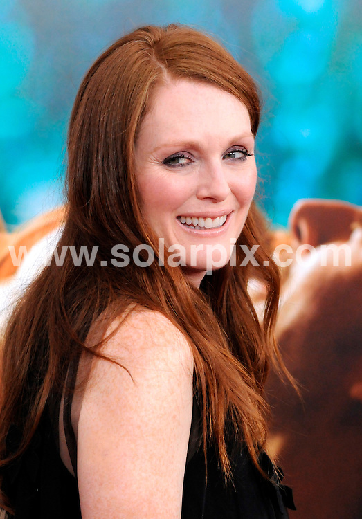 """**ALL ROUND PICTURES FROM SOLARPIX.COM**                                             **SYNDICATION RIGHTS FOR UK, AUSTRALIA, DENMARK, PORTUGAL, S. AFRICA, SPAIN & DUBAI (U.A.E) & ASIA (EXCLUDING JAPAN) ONLY**                                                                                  Arrivals for the """"Crazy, Stupid, Love."""" New York City Premiere at the Ziegfeld Theatre New York City, NY, USA                                                                          .This pic:    Julianne Moore                                                                               JOB REF:   13748    PHZ      DATE:   20.07.11                                                         **MUST CREDIT SOLARPIX.COM OR DOUBLE FEE WILL BE CHARGED**                                                                      **MUST AGREE FEE BEFORE ONLINE USAGE**                               **CALL US ON: +34 952 811 768 or LOW RATE FROM UK 0844 617 7637**"""