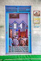 Borobudur, Java, Indonesia.  Men Praying during Friday Noon Prayers at Neighborhood Mosque.