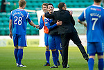 Hibs v St Johnstone.....30.04.11.Kevin Moon gets a hug from Derek McInnes at full time.Picture by Graeme Hart..Copyright Perthshire Picture Agency.Tel: 01738 623350  Mobile: 07990 594431