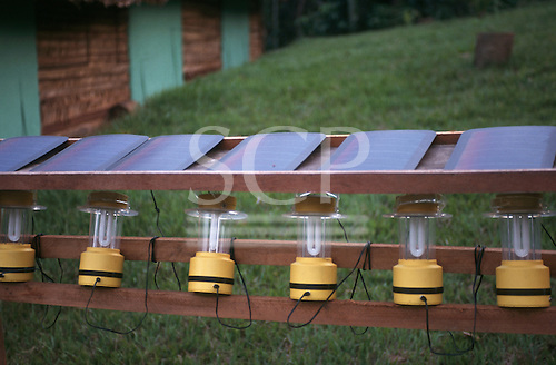 Tataquara, Brazil. Row of lamps being charged by solar cells at an ecotourism lodge hotel in the Amazon, on the Xingu R.