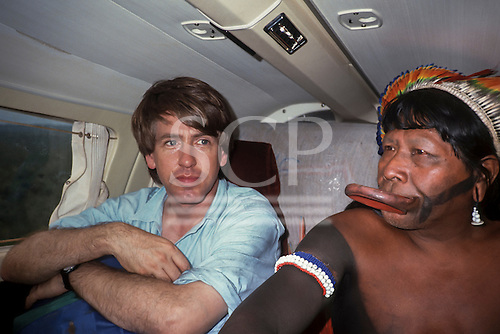 Amazon, Brazil. Larry Cox and Chief Raoni Metuktire aboard a small airplane, 1990