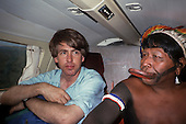 Amazon, Brazil. Larry Cox and Chief Raoni Metuktire aboard a small airplane, 1990