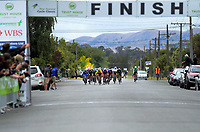 The peloton races to the finish of stage three of the NZ Cycle Classic UCI Oceania Tour (Martinborough circuit) in Wairarapa, New Zealand on Friday, 17 January 2020. Photo: Dave Lintott / lintottphoto.co.nz