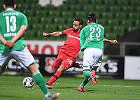 18th May 2020, WESERSTADION, Bremen, Germany; Bundesliga football, Werder Bremen versus Bayer Leverkusen;  Karim Bellarabi (Leverkusen) shoots as he is challenged by Theodor Gebre Selassie (Bremen).