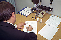 Police surgeon writing up notes after seeing a suspect at a police station. This image may only be used to portray the subject in a positive manner..©shoutpictures.com..john@shoutpictures.com