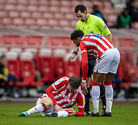 20th March 2021; Bet365 Stadium, Stoke, Staffordshire, England; English Football League Championship Football, Stoke City versus Derby County; Nick Powell of Stoke City looks at his knee after a foul