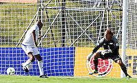 BOGOTA - COLOMBIA - 03-10-2016: Faustino Asprilla (Izq.), jugador del equipo de las leyendas de la Federacion Colombiana de Futbol (FCF), anota gol a Jorge Sere (Der.) portero del equipo de las leyendas de la Federacion Intarnacional de Futbol Asociado (FIFA), durante partido jugado en las canchas de Sede Deportiva de las Selecciones Colombia, Colfœtbol,  entre las leyendas de la Federacion Intarnacional de Futbol Asociado (FIFA) y la Federacion Colombiana de Futbol (FCF), en la nueva sede de la FCF, en Bogota. / Faustino Asprilla (L) player of the team of the legends of the Colombian Football Federation (FCF), scored a goal to Jorge Sere (R) goalkeeper of the team of the legends of the Intarnacional Federation of Football Association (FIFA), during the match playing in the fields of Headquarters of the Teams Colombia, Colfutbol, between the legends of the Federation Intarnacional de Football Association (FIFA) and the Colombian Football Federation (FCF) in the new headquarters of the FCF, in Bogota. / Photo: VizzorImage / Luis Ramirez / Staff.