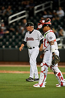 Birmingham Barons pitching coach Richard Dotson (40) and catcher Yermin Mercedes (right) walk to the mound for a visit during a Southern League game against the Chattanooga Lookouts on May 1, 2019 at Regions Field in Birmingham, Alabama.  Chattanooga defeated Birmingham 5-0.  (Mike Janes/Four Seam Images)