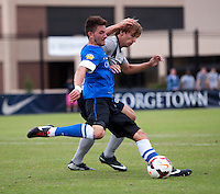 Brett Campbell (16) of Georgetown has the ball cleared away from him by Eric Labourdette (6) of Creighton during the game at Shaw Field on the campus of the Georgetown University in Washington, DC.  Georgetown tied Creighton, 0-0, in double overtime.