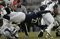 State College, PA - 11/27/2010:  DT Devon Still (71) dives to tackle the MSU ballcarrier.  Penn State lost to Michigan State by a score of 28-22 on Senior Day at Beaver Stadium...Photo:  Joe Rokita / JoeRokita.com..Photo ©2010 Joe Rokita Photography