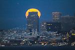 July summer full moon over San Francisco skyline seen from Marin county.