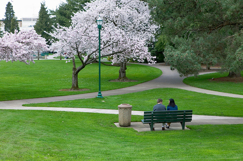 Couple on bench at Oregon State Capitol grounds. Salem, Oregon