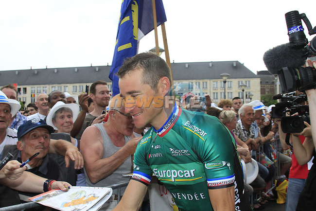 Thomas Voeckler (FRA) Team Europcar signs autographs at the Team Presentation Ceremony before the 2012 Tour de France in front of The Palais Provincial, Place Saint-Lambert, Liege, Belgium. 28th June 2012.<br /> (Photo by Eoin Clarke/NEWSFILE)