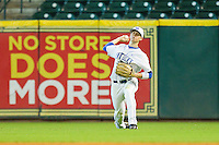 Right fielder J.T. Riddle #10 of the Kentucky Wildcats makes a throw to home plate against the Houston Cougars at Minute Maid Park on March 5, 2011 in Houston, Texas.  Photo by Brian Westerholt / Four Seam Images