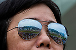 A general view of the racecoruse is seen reflected in a ladies sunglasses during Hong Kong Racing at Sha Tin Racecourse on October 01, 2018 in Hong Kong, Hong Kong. Photo by Yu Chun Christopher Wong / Power Sport Images
