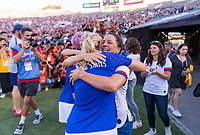 PASADENA, CA - AUGUST 4: Allie Long #20 and Joy Fawcett hug during a game between Ireland and USWNT at Rose Bowl on August 3, 2019 in Pasadena, California.