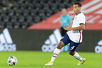 SWANSEA, WALES - NOVEMBER 12: Tyler Adams #4 of the United States moves to the ball during a game between Wales and USMNT at Liberty Stadium on November 12, 2020 in Swansea, Wales.