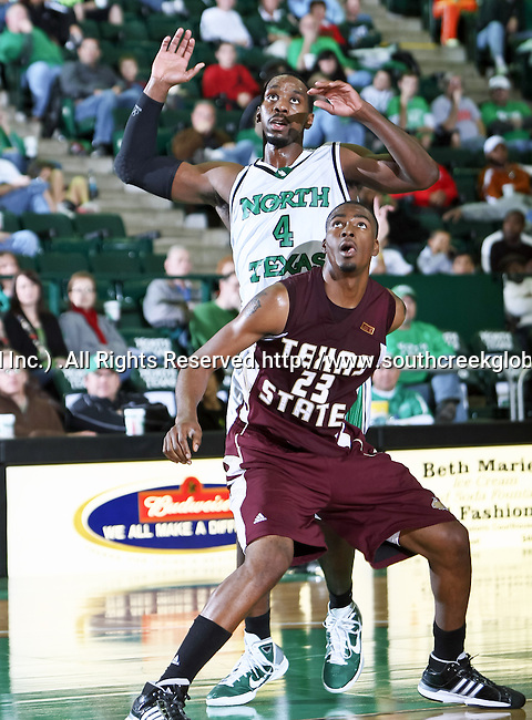 Texas State Bobcats forward Cameron Johnson (23) blocks out North Texas Mean Green forward George Odufuwa (4) in the game between the Texas State Bobcats and the University of North Texas Mean Green at the North Texas Coliseum,the Super Pit, in Denton, Texas. UNT defeated Texas State 85 to 62