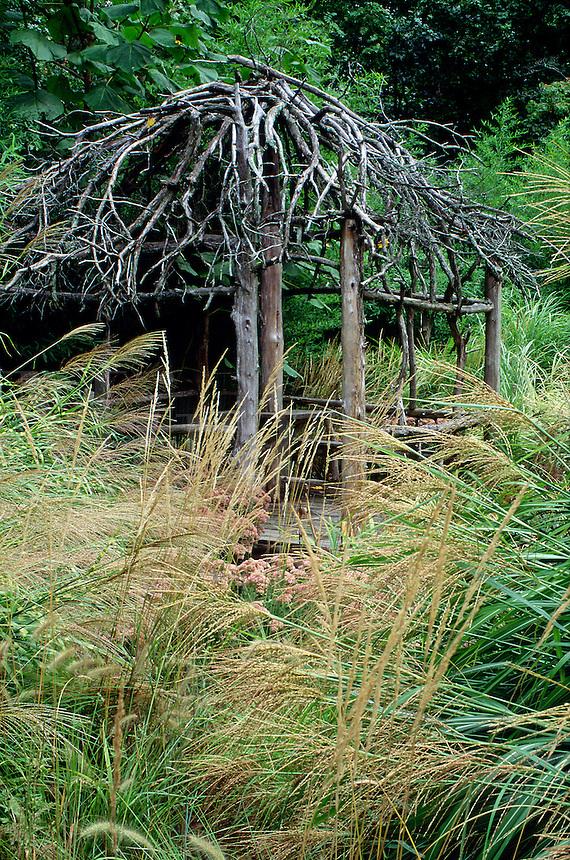 Garden with brush gazebo and ornamental grasses #5609. Virginia.