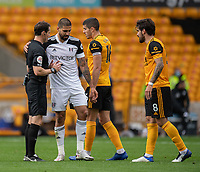 Referee Darren England (left)  cautions Fulham's Aleksandar Mitrovic (centre) for a foul on Wolverhampton Wanderers' Ruben Neves (right)  <br /> <br /> Photographer David Horton/CameraSport<br /> <br /> The Premier League - Wolverhampton Wanderers v Fulham - Sunday 4th October 2020 - Molineux Stadium - Wolverhampton<br /> <br /> World Copyright © 2020 CameraSport. All rights reserved. 43 Linden Ave. Countesthorpe. Leicester. England. LE8 5PG - Tel: +44 (0) 116 277 4147 - admin@camerasport.com - www.camerasport.com