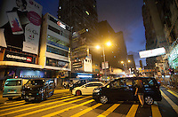 Cars placed strategically on a pedestrian crossing are seen blocking Argyle Street, Mong Kok, Kowloon, Hong Kong, China, 29 September 2014. Several areas of the city including Central, Admiralty, Causeway Bay, as well as Mong Kok in Kowloon, were locked down by Occupy Central civil disobedience teams who fanned out across the city blocking major thoroughfares as well as side streets, with rip ties, metal barriers, police road cones and any other street furniture available to hand.