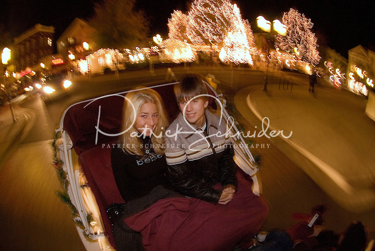 A young couple keep warm during the annual Christmas tree lighting event at Birkdale Village in Huntersville, NC. Birkdale Village combines the best of shopping, dining, apartments and entertainment venues within a 52-acre mixed-use development.