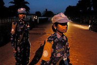 LIBERIA, 09/04/2007..Vaishali (centre) and Jayshree on night patrol in the 'old road' area of Monrovia....© 2007 Aubrey Wade. All rights reserved...