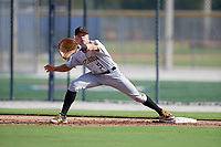 Pittsburgh Pirates Paul Brands (5) stretches for a throw during an Instructional League game against the Toronto Blue Jays on October 14, 2017 at the Englebert Complex in Dunedin, Florida.  (Mike Janes/Four Seam Images)