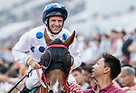Jockey Brett Prebble riding Contentment celebrates after winning the Champions Mile (1600m) on 07 May 2017, at the Sha Tin Racecourse  in Hong Kong, China. Photo by Chris Wong / Power Sport Images