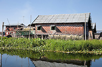 Myanmar, Burma.  Houses on Stilts, Inle Lake Village, Shan State.