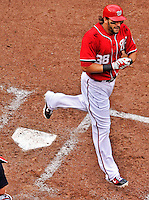 25 September 2011: Washington Nationals outfielder Michael Morse comes home to score after hitting a 2-run dinger against the Atlanta Braves at Nationals Park in Washington, DC. The Nationals shut out the Braves 3-0 to take the rubber match third game of their 3-game series - the Nationals' final home game for the 2011 season. Mandatory Credit: Ed Wolfstein Photo