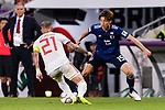 Osako Yuya of Japan (R) fights for the ball with Seyed Ashkan Dejagah of Iran (L) during the AFC Asian Cup UAE 2019 Semi Finals match between I.R. Iran (IRN) and Japan (JPN) at Hazza Bin Zayed Stadium  on 28 January 2019 in Al Alin, United Arab Emirates. Photo by Marcio Rodrigo Machado / Power Sport Images