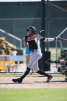 Chicago White Sox shortstop Lency Delgado (12) follows through on his swing during an Instructional League game against the Oakland Athletics at Lew Wolff Training Complex on October 5, 2018 in Mesa, Arizona. (Zachary Lucy/Four Seam Images)