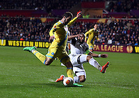 Swansea, UK. Thursday 20 February 2014<br /> Pictured L-R: Gonzalo Higuain of Napoli has his cross stopped by Ashley Williams of Swansea<br /> Re: UEFA Europa League, Swansea City FC v SSC Napoli at the Liberty Stadium, south Wales, UK