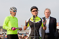 Universite Laval teacher Jean-Marie De Koninck speaks as businessman Louis Garneau and Quebec Premier Jean Charest look on before the Ride in Silence event in Quebec City May 19, 2010. Ride in Silence is a worldwide event being held tonight to honor those injured or killed while cycling on public roads.<br /> <br /> PHOTO :  Francis Vachon - Agence Quebec Presse