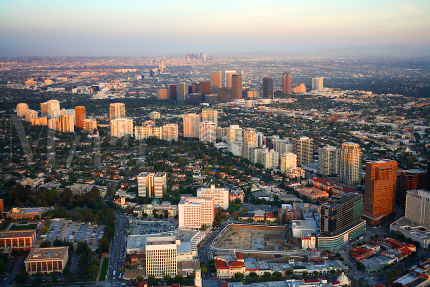 Aerial view of Beverly Hills with Wilshire Blvd in the foreground and Santa Monica Blvd, Los Angeles, California.