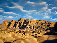Colorful rock formations as seen from Golden Canyon Trail. Death Valley National Park, California. Sky has been added