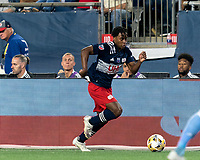 FOXBOROUGH, MA - SEPTEMBER 11: DeJuan Jones #24 of New England Revolution dribbles down the wing during a game between New York City FC and New England Revolution at Gillette Stadium on September 11, 2021 in Foxborough, Massachusetts.