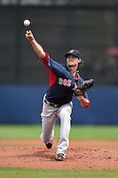 Boston Red Sox pitcher Clay Buchholz (11) during a spring training game against the Tampa Bay Rays on March 25, 2014 at Charlotte Sports Park in Port Charlotte, Florida.  Boston defeated Tampa Bay 4-2.  (Mike Janes/Four Seam Images)