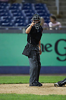 Home plate umpire Steven Jaschinski makes a strike call during the Carolina League game between the Fayetteville Woodpeckers and the Wilmington Blue Rocks at Frawley Stadium on June 6, 2019 in Wilmington, Delaware. The Woodpeckers defeated the Blue Rocks 8-1. (Brian Westerholt/Four Seam Images)