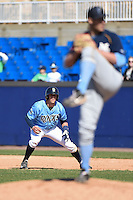 Wilmington Blue Rocks third baseman Hunter Dozier (18) leads off first as Alex Gonzalez delivers a pitch during a game against the Myrtle Beach Pelicans on April 27, 2014 at Frawley Stadium in Wilmington, Delaware.  Myrtle Beach defeated Wilmington 5-2.  (Mike Janes/Four Seam Images)