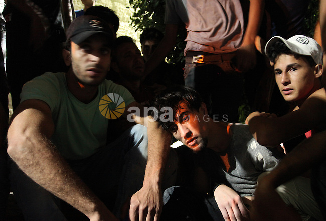 People mourn the death of Palestinian youth Abdulrahman Al-Dabag, who medics said was shot dead by Israeli troops on Friday, at a hospital in the central Gaza Strip September 9, 2016. Photo by Ashraf Amra