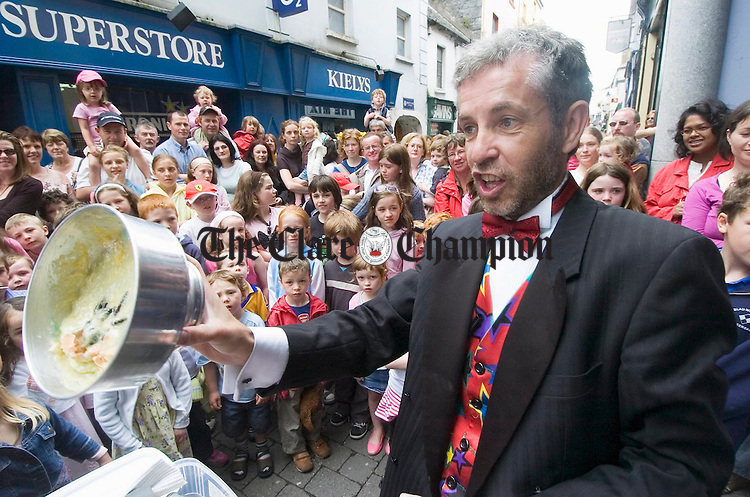 Magician Paul Beattie does his thing for a captive audience during the Ennis Street Festival. Photograph by John Kelly.