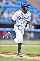 Asheville Tourists center fielder Shael Mendoza (21) runs to first base during a game against the Greensboro Grasshoppers at McCormick Field on May 10, 2018 in Asheville, North Carolina. The Tourists defeated the Grasshoppers 14-10. (Tony Farlow/Four Seam Images)