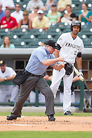 Home plate umpire Joseph Born makes an out call during the game between the Pawtucket Red Sox and the Charlotte Knights at BB&T Ballpark on August 8, 2014 in Charlotte, North Carolina.  The Red Sox defeated the Knights  11-8.  (Brian Westerholt/Four Seam Images)