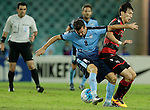 SYDNEY - APRIL 05:  Milos Dimitrijevic of Sydney FC is tackled during the AFC Champions League group H match between Sydney FC and Pohang Steelers on 05 April 2016 held at Sydney Football Stadium in Sydney, Australia. Photo by Mark Metcalfe / Power Sport Images   *** Local Caption *** Milos Dimitrijevic