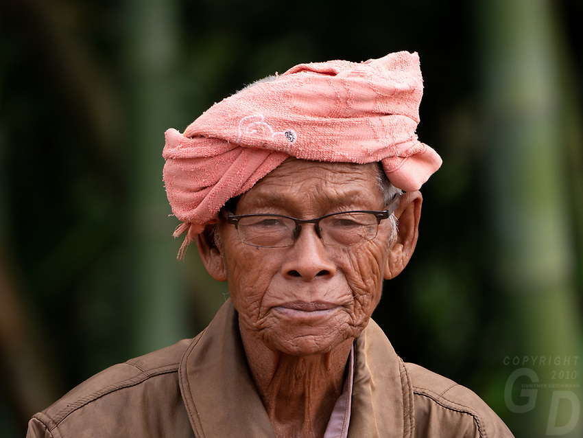 Rural portraits in the Shan State Myanmar waiting at the rural road for his transport
